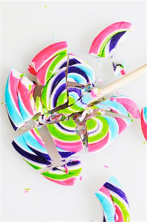 A Broken Swirled Lollipop; On a White Background Stock Photo - Premium Royalty-Free, Code: 659-07026812