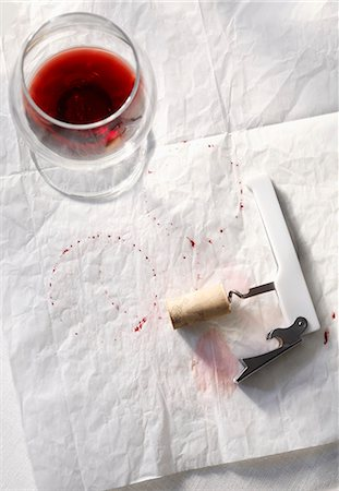 spotted - Half Empty Glass of Red Wine with Corkscrew and Wine Stains on Paper Stock Photo - Premium Royalty-Free, Code: 659-07026862