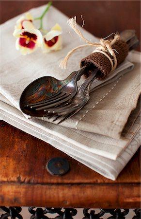Old Silverware Bundled on a Napkin Stock Photo - Premium Royalty-Free, Code: 659-07027042