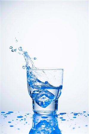 drinking water glass - Water splashing out of glass Stock Photo - Premium Royalty-Free, Code: 659-07027175
