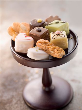 four - Assorted biscuits and petits fours on a cake stand Stock Photo - Premium Royalty-Free, Code: 659-07027250
