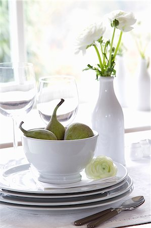 set - A stack of crockery with figs and a vase of white ranunculus flowers Stock Photo - Premium Royalty-Free, Code: 659-07027626