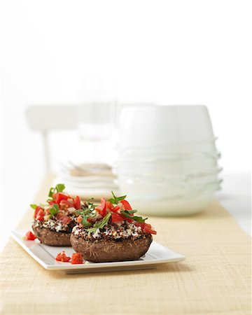 recipe - Stuffed mushrooms with tomatoes and rocket Stock Photo - Premium Royalty-Free, Code: 659-07027837