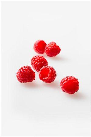 Fresh Raspberries on a White Background Stock Photo - Premium Royalty-Free, Code: 659-07028008