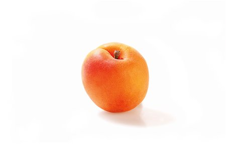An apricot against a white background Stock Photo - Premium Royalty-Free, Code: 659-07028097