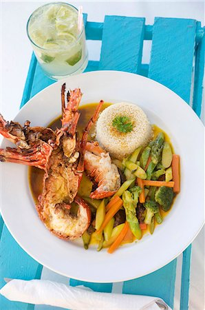 Halved Lobster with Couscous and Vegetables; In a White Bowl Stock Photo - Premium Royalty-Free, Code: 659-07028136