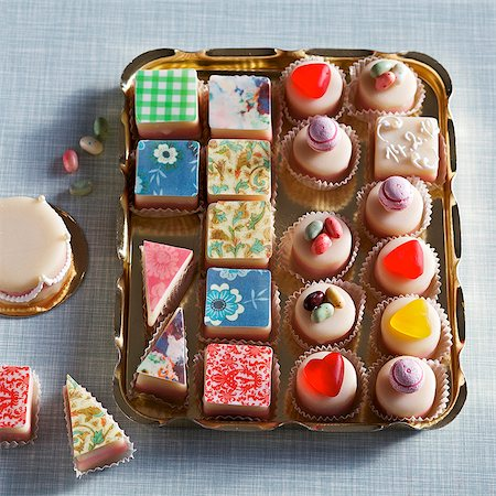 sweets - Colourful petits fours on a gold tray Stock Photo - Premium Royalty-Free, Code: 659-07028423