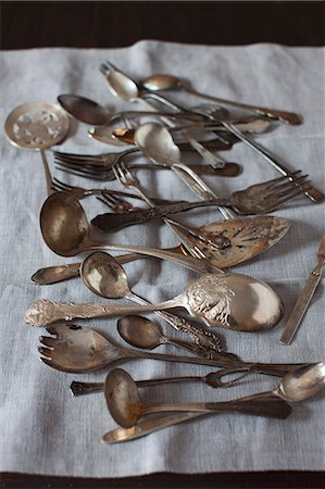 Old Spoons and Forks on Linen Stock Photo - Premium Royalty-Free, Code: 659-07028462