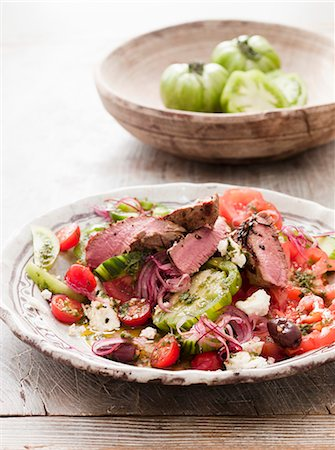 Lamb salad with tomatoes, feta and olives (Greece) Stock Photo - Premium Royalty-Free, Code: 659-07028707