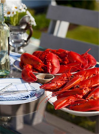 Platters of Fresh Cooked Lobsters on an Outdoor Table Stock Photo - Premium Royalty-Free, Code: 659-07068549