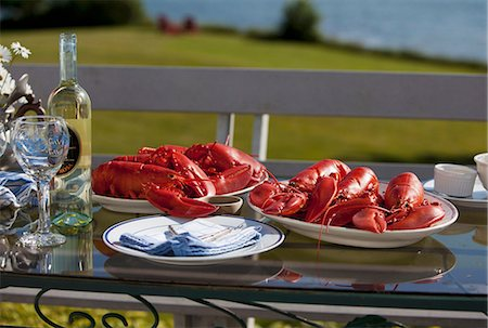 Platters of Cooked Lobsters on an Outdoor Table; White Wine Stock Photo - Premium Royalty-Free, Code: 659-07068550