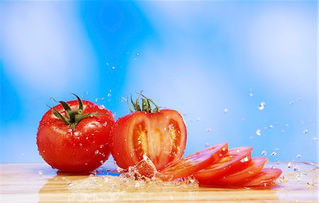 Tomatoes with a splash of water Stock Photo - Premium Royalty-Free, Code: 659-07068718