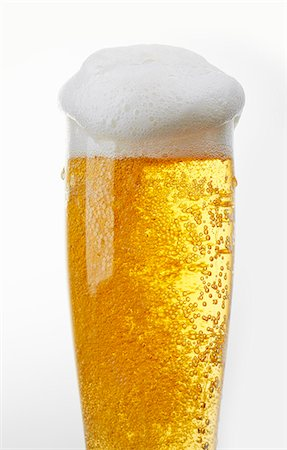 A glass of light beer with beer foam Stock Photo - Premium Royalty-Free, Code: 659-07068724