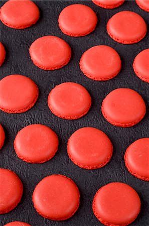 french (places and things) - Freshly baked red macaroon halves on a slate surface Stock Photo - Premium Royalty-Free, Code: 659-07068863