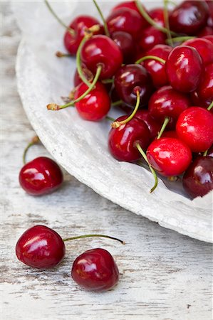 Fresh cherries on a stone plate Stock Photo - Premium Royalty-Free, Code: 659-07068890