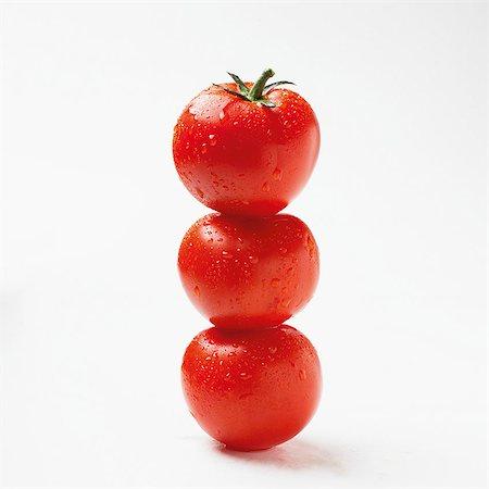 Three tomatoes, stacked Stock Photo - Premium Royalty-Free, Code: 659-07069035
