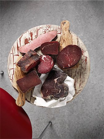 smoked - Assorted chunks of smoked ham (view from above) Stock Photo - Premium Royalty-Free, Code: 659-07069451
