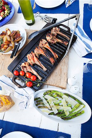season - Grilled lamb chops, cherry tomatoes, green asparagus with parmesan, and roast potatoes Stock Photo - Premium Royalty-Free, Code: 659-07069580
