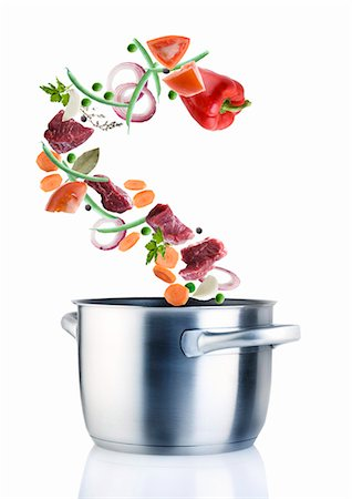 recipe - Ingredients for a stew falling into a saucepan Stock Photo - Premium Royalty-Free, Code: 659-07069878