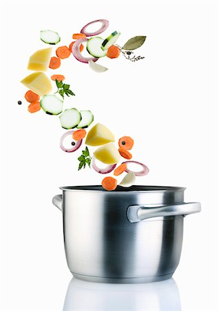 Ingredients for vegetable soup falling into a saucepan Stock Photo - Premium Royalty-Free, Code: 659-07069880
