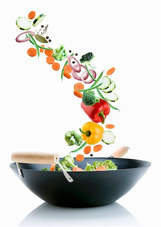 recipe - Vegetables falling into a wok Stock Photo - Premium Royalty-Free, Code: 659-07069881