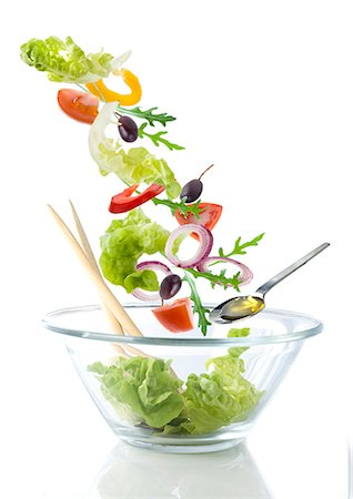 salad - Salad ingredients falling into a glass bowl Stock Photo - Premium Royalty-Free, Code: 659-07069883
