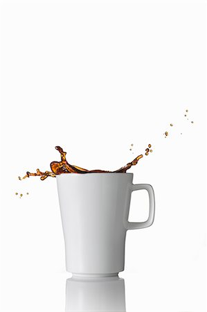dripping silhouette - Black coffee splashing out of the mug Stock Photo - Premium Royalty-Free, Code: 659-07597254