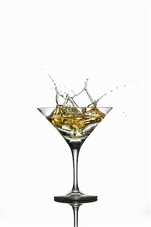 A martini splashing out of a glass Stock Photo - Premium Royalty-Free, Code: 659-07597255