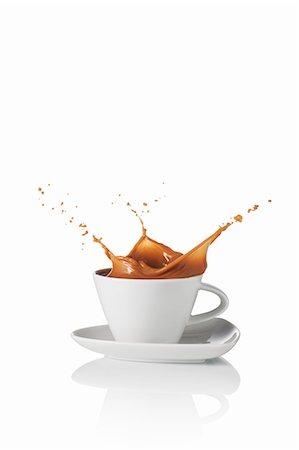 dripping silhouette - A latte splashing out of the cup Stock Photo - Premium Royalty-Free, Code: 659-07597257