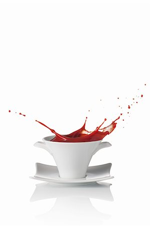 dripping silhouette - Tomato soup splashing out of a soup bowl Stock Photo - Premium Royalty-Free, Code: 659-07597263