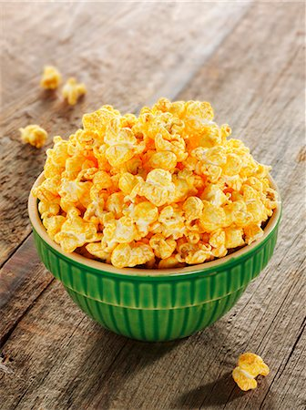 Bowl of Cheese Flavored Popcorn Stock Photo - Premium Royalty-Free, Code: 659-07597438