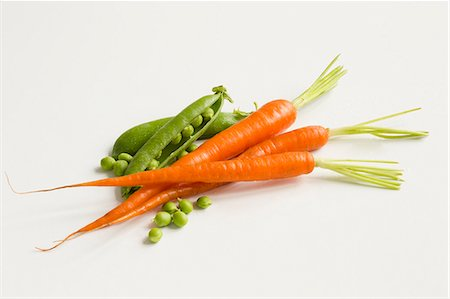 Fresh Peas and Carrots on a White Background Stock Photo - Premium Royalty-Free, Code: 659-07597697