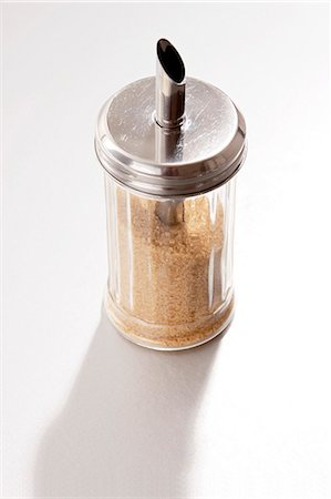 A sugar shaker filled with brown sugar Stock Photo - Premium Royalty-Free, Code: 659-07597740