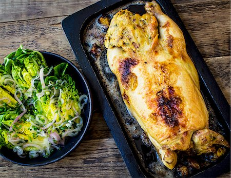 rustic - 37. Whole roast chicken stuffed with salad Stock Photo - Premium Royalty-Free, Code: 659-07597905