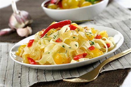 rustic - Tagliatelle with chilli and yellow cherry Stock Photo - Premium Royalty-Free, Code: 659-07598123
