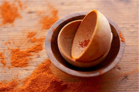paprika - Small Wooden Bowls with Spilled Paprika Stock Photo - Premium Royalty-Free, Code: 659-07598560