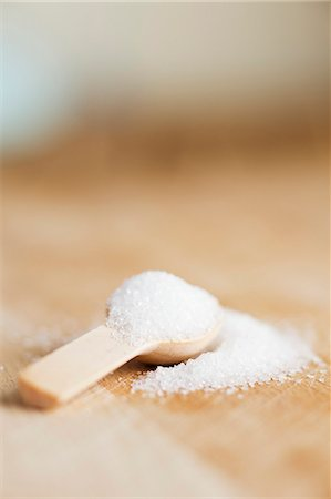 sugar - Granulated sugar on a wooden spoon Stock Photo - Premium Royalty-Free, Code: 659-07598797