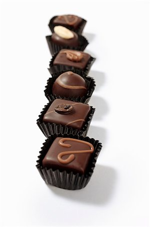 silhouettes - A row of assorted filled chocolates in paper cases Stock Photo - Premium Royalty-Free, Code: 659-07598911