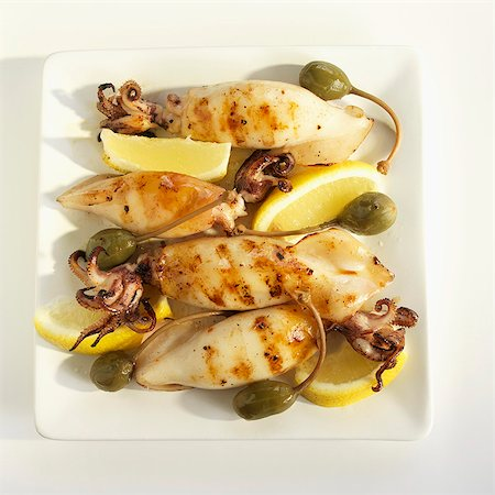 Calamari Grilled with Lemons and Capers Stock Photo - Premium Royalty-Free, Code: 659-07599051