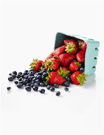 strawberries - Fresh Strawberries and Blueberries Spilling from a Carton Stock Photo - Premium Royalty-Free, Code: 659-07599143