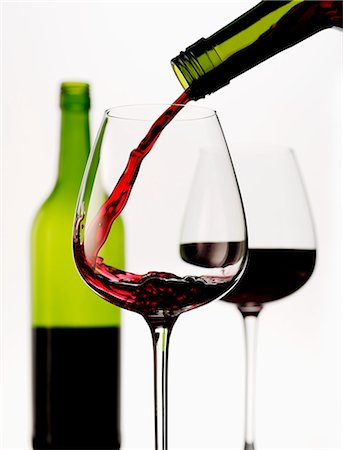 Red wine being poured into a glass Stock Photo - Premium Royalty-Free, Code: 659-07599265