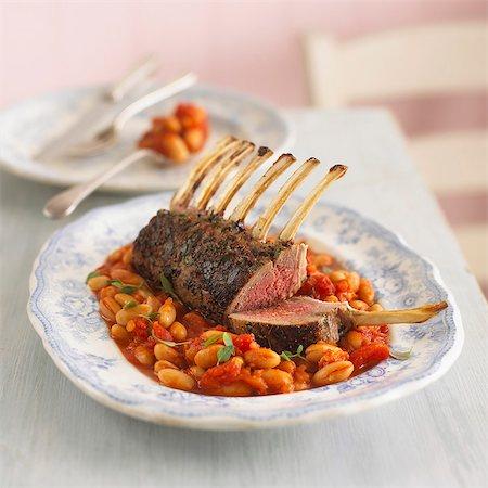 rib - Rack of lamb on a bean and tomato medley Stock Photo - Premium Royalty-Free, Code: 659-07599285