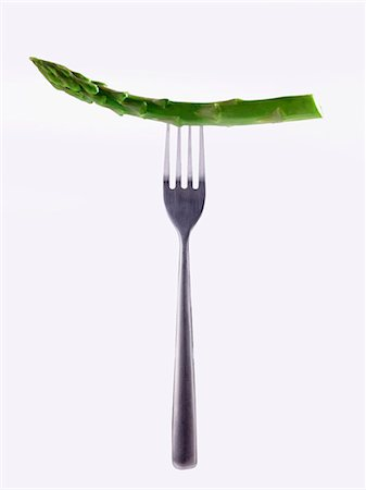 fork - A stem of green asparagus on a fork Stock Photo - Premium Royalty-Free, Code: 659-07599294