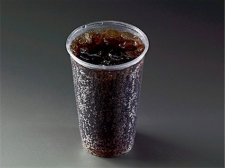drink (non-alcohol) - Cola with ice cubes in a plastic cup Stock Photo - Premium Royalty-Free, Code: 659-07599321