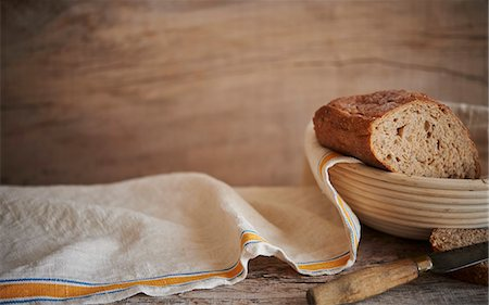 Fresh Artisan Bread on wooden surface with cloth Stock Photo - Premium Royalty-Free, Code: 659-07609592
