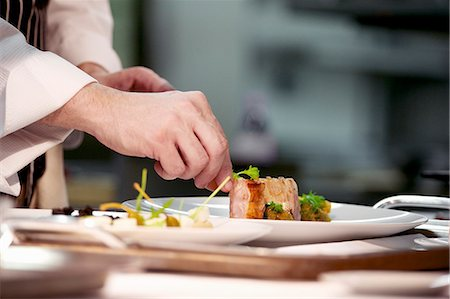 restaurant - Chef plating up pork dish during service at working restaurant Stock Photo - Premium Royalty-Free, Code: 659-07609758