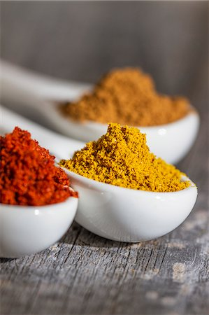 Three spoons of different spices (close-up) Stock Photo - Premium Royalty-Free, Code: 659-07609771