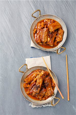 rib - Pork ribs braised in soy sauce with sugar, star anise, garlic and ginger Stock Photo - Premium Royalty-Free, Code: 659-07609813