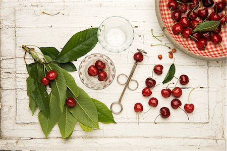 Fresh red cherries with a cherry pitter Stock Photo - Premium Royalty-Free, Code: 659-07609945