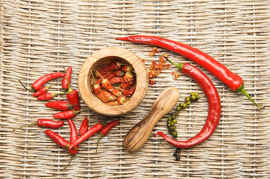 Chilli peppers in an olive wood mortar Stock Photo - Premium Royalty-Free, Image code: 659-07609942